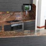 Similar to Fusion Quartzite with less blue and more deep red tones.