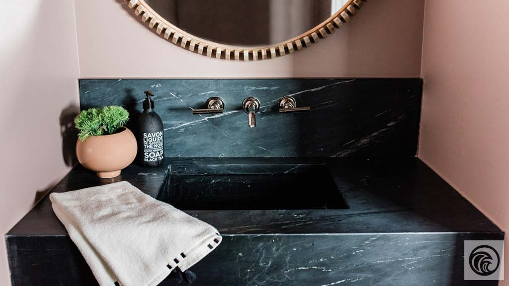 A velvet black surface with deep grey and white veining running across.